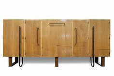 Meuble d'appui à usages multiples (1937) Poirier verni et acajou, métal, intérieur cuir. René Herbst.
