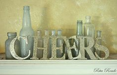Michelle, I found a use for the old bottles you gave me:)  New Year's decor: Cheers