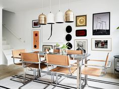 metal dining table + chairs with beige leather + metallic pendants