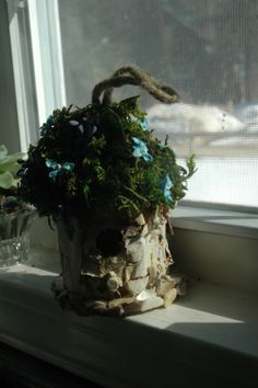 This is a little birch bark bird house I made - complete with moss, tiny silk forget me nots and little pearlescent stones along the bottom