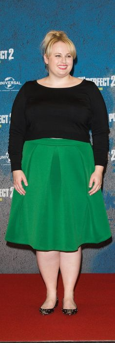 Rebel Wilson paired her kelly green pleated midi skirt with eye-catching embellished black flats and a simple long-sleeve sweater. Her look was movable, comfortable, and most importantly, fun for the Berlin photo call of Pitch Perfect 2.
