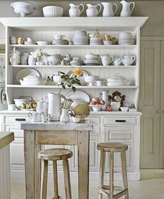 White dish hutch and an example of white washed wood for the ceiling