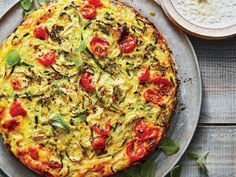 This is a fresh riff on spaghetti pie, where zoodles stand in for spaghetti and sweet grape tomatoes replace pasta sauce. Cut wedges from...