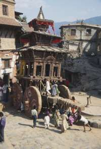 Nepal, Bhaktapur, wooden chariot being pulled through a street at Nepali New Year