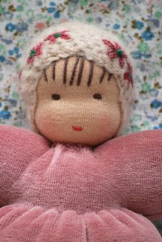 crochet cap with sweet little petals on cuddle doll: Woody & Purl Waldorf doll