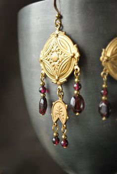 Olympia earrings by Lorliaswood, raw brass and natural garnet.