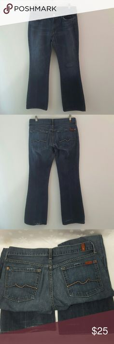 7 for all Mankind Flare Jeans 7 for all Mankind Flare Jeans.  Faded medium blue color.  Wear on tops of pockets and cuffs.  Heavy fraying on backs of legs above the cuffs,  including small hole, see 3rd picture.  These can be made into shorts if you don't like the fraying. Size 31. Waist measures 15.5 inches,  inseam is 31 inches.  8 inch rise. 7 For All Mankind Jeans Flare & Wide Leg