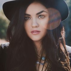 Lucy Hale's makeup and hair are perfect in this photo. We love her accessories too! | Pretty Little Liars
