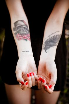 skull + feather arm tattoos