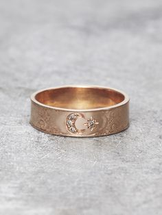 A cosmic sisterhood is shared between the Moon and her favorite sparkling Star, in this precious & luminous Moon Goddess ring. Four shimmering Champagne Diamonds are set in Solid 14K Rose Gold and surrounded by delicately scrolling, antique & leafy, hand-engraved details. Band measures approx. 5.5 mm wide and features 4 genuine brilliant cut diamonds. Designed and handcrafted with Love by Elise Perelman in NYC. We recommend double-checking your ring size with a local jeweler before ordering…