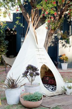 Small Back Garden Designs And Ideas : Eclectic Back Garden Designs With  White Indian Tent Ornament Also Culture Cushions Pattern Also Beauty Plants  On Clay ...