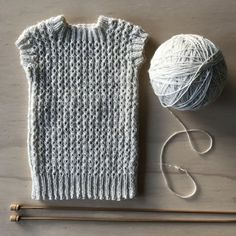 Singlet for a newborn knitting project by Heather B | LoveKnitting