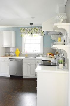 White kitchen with blue wall color (Colorado Grey by Benjamin Moore) and grey accents - perfect palette for our house!