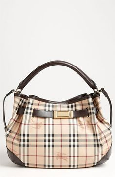 Burberry Handbag Clearance – 'Haymarket Check' Hobo Take 25% off the 'Haymarket Check' Hobo. A leather belt threaded through gleaming grommets gently gathers a curvy hobo patterned with checks and accented with shadowy logo crests. A single rolled handle and an optional adjustable shoulder strap provide convenient carrying options. 'Haymarket Check' Hobo Reg price: $1,195.00 Sale price: $896.25