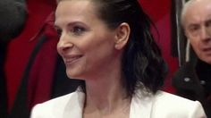 Juliette Binoche arrived in the spotlight of the Berlin Film Festival donning a daring white gown