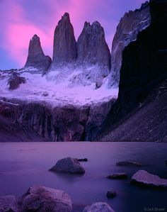 The Torres glow pink under a brilliant December sunrise, Torres del Paine, Chile