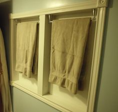 "DIY: How to Build a Cabinet Inside the Wall - Love the idea of putting the towel racks inside the wall like this for several reasons - great for small bathrooms (like our guest bath) and also to stop folks from using the towel racks as grab bars. Plus, I just like the way it frames the towels & makes them look ""artsy""."