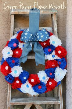 How to make a Patriotic Crepe Paper Flower Wreath.  Such a pretty Patriotic statement.  #makeitfuncrafts