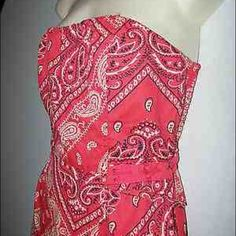 Anthropology Wild Horses dress Put on your cowboy boots and live a little with this red bandana patterned dress. The ties on the side are of a corset style . Sleeveless but no worries looks great with your favorite shirt underneath . Midi length. Anthropologie Dresses Midi