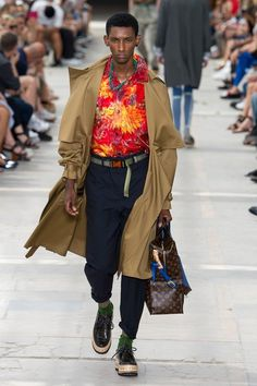 View the complete Spring 2018 menswear collection from Louis Vuitton.