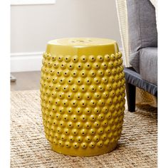 Update your garden with this stylish stool from Abbyson Living. Featuring a Yellow finish, the stool adds a new and functional accent to any garden.