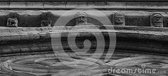 Shot in black and white, detail on the sculpture on facade of this historic church representing some characters. Set in Lleida, Catalunya,  Spain, Europe