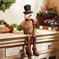 The Rustic Snowman Shelf Sitter will keep a watchful eye on your holiday decor! #kirklands #holidaydecor #KirklandsHoliday