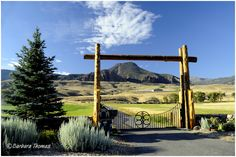 """The view of this ranch gate and beyond, a few miles from Cody, Wyoming was one of those """"stop the car!"""" moments."""