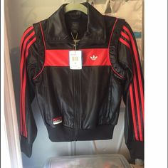 Adidas track jacket -I DON'T TRADE❗️❗️❗️Brand new with tags Adidas red and black track jacket  made with a shiny material that makes it look like leather ! lots of detail this jacket is def  a show stopper ❤️❤️ Adidas Jackets & Coats