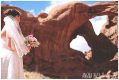 What a beautiful day for a wedding at Arches National Park. Flowers by Manna Floral Design. Photo by Angela Hayes