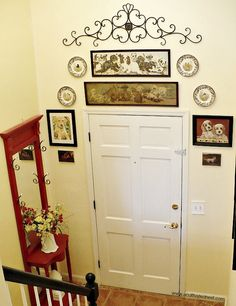 Cute entry way with gallery wall and red hall tree