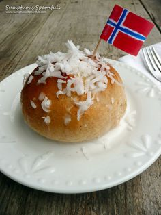 """Skolebrød ~ Norwegian """"School Buns"""". Lightly sweet buns spiced with cinnamon & cardamom, stuffed with a thick vanilla custard filling and then glazed and sprinkled with coconut."""