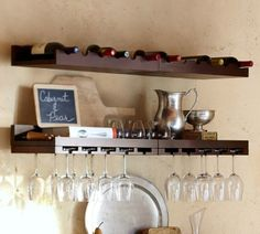 contemporary wall shelves by Pottery Barn.  A simple solution for over a winebar.
