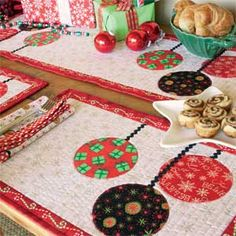 Festive holiday prints bring Christmas joy to this charming Gather 'Round table ensemble. Our pattern includes instructions for 4 quilted place mats, 4 napkins, and 1 table runner quilt.