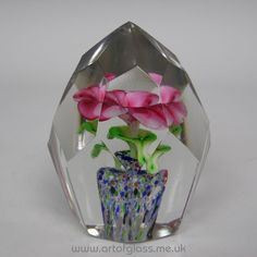 Bohemian multi-facet cut glass paperweight with lamp worked pink flower