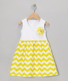 #zulily With a darling rosette accent and a skirt soaked in cheerful yellow zigzags, this soft slip-on frock will bring plenty of playful panache to any day.