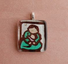 Glass pendant with handcut hanji paper traditional Korean design. $16.00, via Etsy.