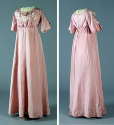 Dress, 1902. Pink silk lined with white silk. Bodice embroidered with Art Nouveau-style pink roses, pale green winding stems, and leaves in heavy silk thread. Neckline insert of embroidered yellow tulle with tassels. Empire style, piped waist. Slit sleeves. National Museum of Finland