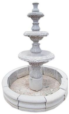 This extraordinary architectural stone fountain, handmade with round basin and free standing. In colonial state of Michoacan between town of Quiroga and Patzcuaro we produce hand carved stone fountains.
