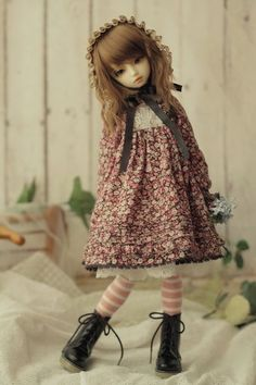 what an adorable, life-like doll!!