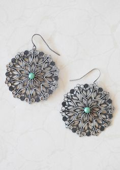"""Till Eternity Earrings 9.99 at shopruche.com. With an ornate filigree design and glittering green accents, these pewter colored earrings are the perfect understated accessory.1.5"""" diameter"""