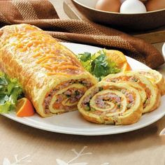 Ham and Cheese Omelet Roll - This makes a great brunch for company. Add some fruit and its a meal. A tip: When pouring the eggs into the pan, put the pan on the oven rack and bring the mixture to the pan and pour it into the pan. That way no pan full of eggs spilling all over.