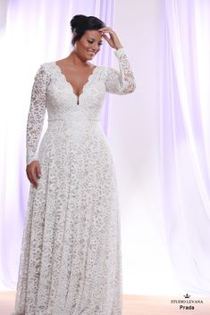 Signature plus size lace wedding gown with long sleeves. Prada. Studio Levana