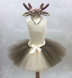 "Reindeer Tutu Skirt Children's Costume Set w/ Antler Headband My adorable handmade Reindeer Tutu Skirt Costume Set is perfect for a First Christmas Photo Shoot! The tutu skirt is 10"" long with a str"