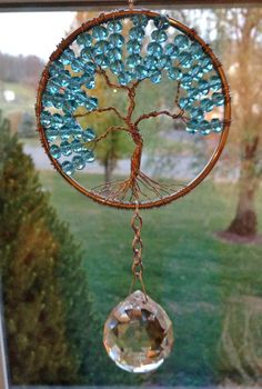 Hey, I found this really awesome Etsy listing at https://www.etsy.com/listing/211343702/crystal-tree-of-life-sun-catchers-fung