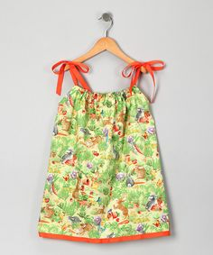 Frolicking in the flowers just got sweeter with this delightful dress. With an elegant print and comfy adjustable shoulder ties, playtime frills are sure to follow.100% cottonMachine wash; tumble dryMade in the USA