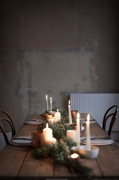 INGREDIENTS LDN candlelit tablescape A simple green and copper tablescape styled using a single bunch of flowers consisting mostly of green leaves and a few evergreen twigs