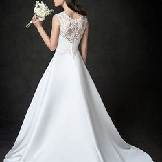 @kennethwinston delivering demur and elegant styles for every bride looking for that one unique dream dress that speaks volumes! #KennethWinston
