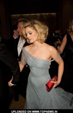 I love everything about her in this picture! The hair, the makeup and THE dress!