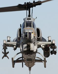 A USMC Bell AH-1 Super Cobra outfitted with, left to right, AIM-9 Sidewinder anti-aircraft missile, 19xFFAR pod & TOW anti-armor missile rack.